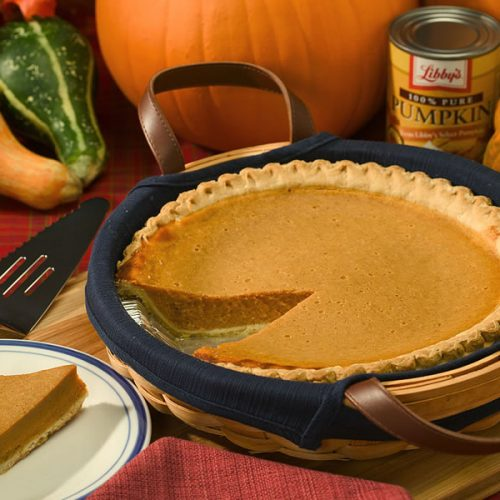maple vanilla pumpkin pie recipe in a dish with pumpkins