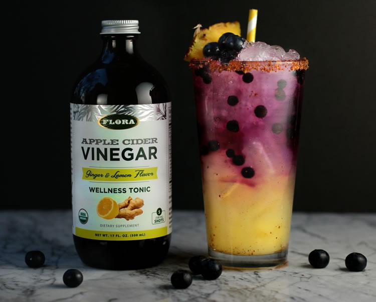 Sparkling Pineapple Blueberry Refresher recipe with Flora Apple Cider Vinegar Ginger + Lemon Wellness Shot