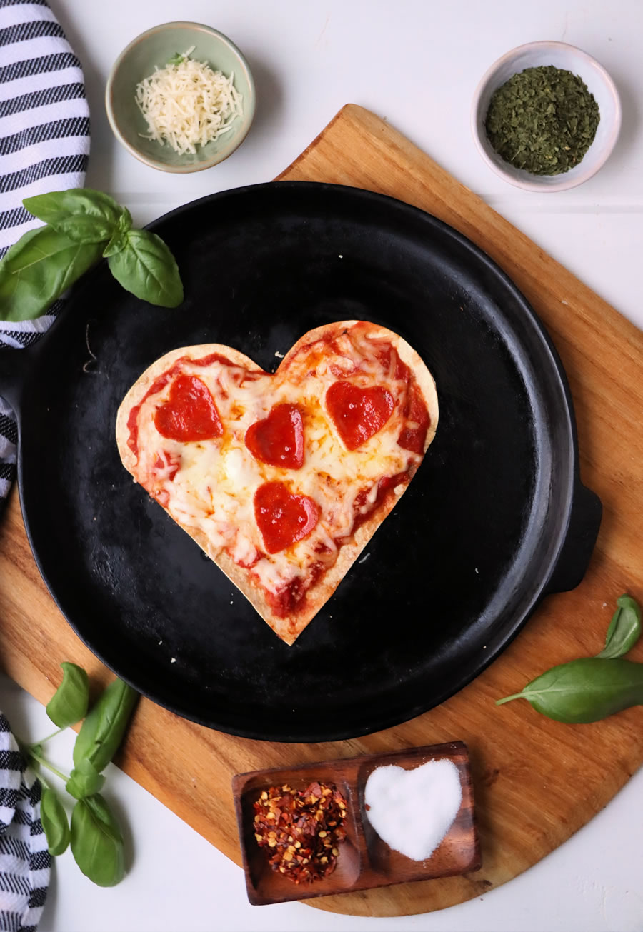 Low-Carb Valentines Day Tortilla Pizza on skillet with basil