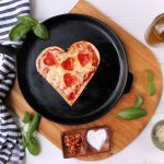 heart shaped low carb tortilla pizza with heart shaped pepperoni.