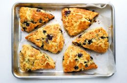 blueberries scones on a parchment line tray