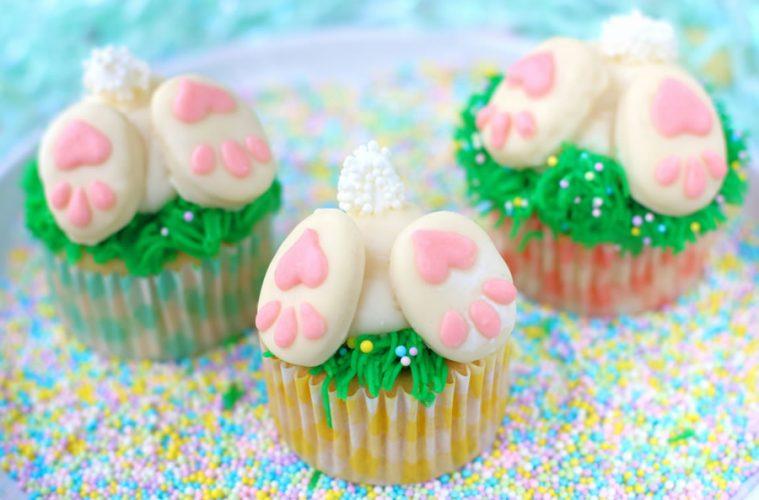 three bunny butt cupcakes on sprinkles