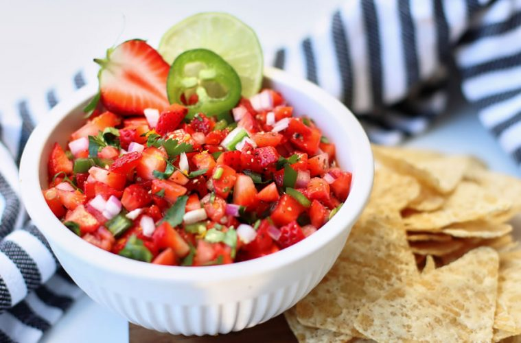 Strawberry Jalapeño Salsa in a white bowl with tortilla chips