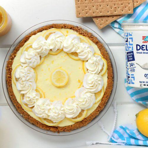 Greek Yogurt Lemon Cream Pie made with Delta Greek yogurt and decorated with lemon slices and whipped cream| onbetterliving.com